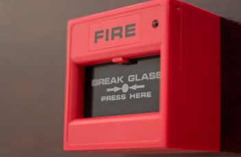 A close-up of a fire alarm box